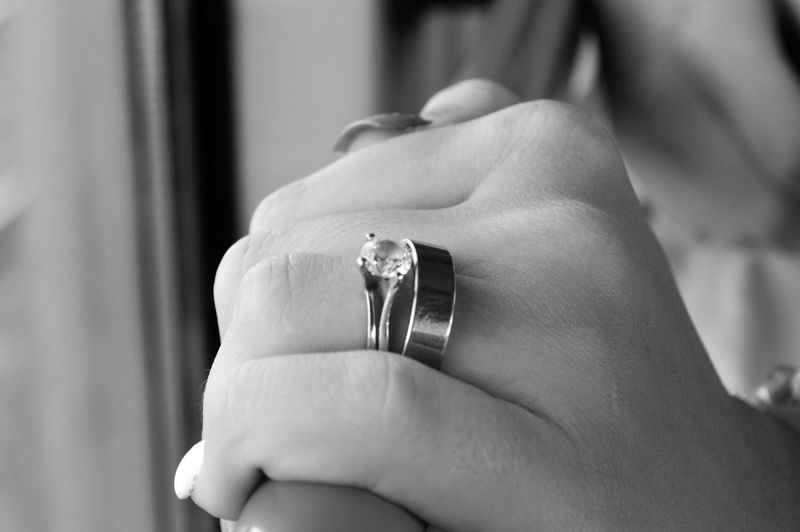 Close-up of woman wearing engagement rings