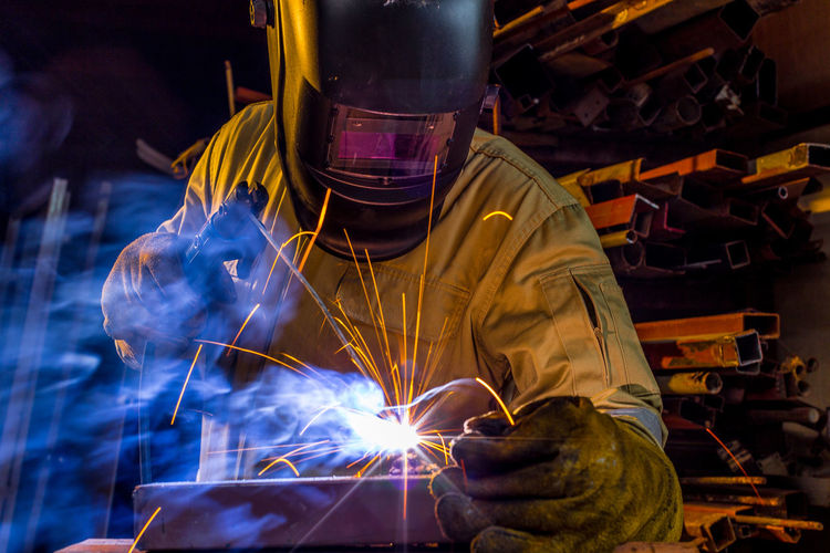 Welder welding in workshop