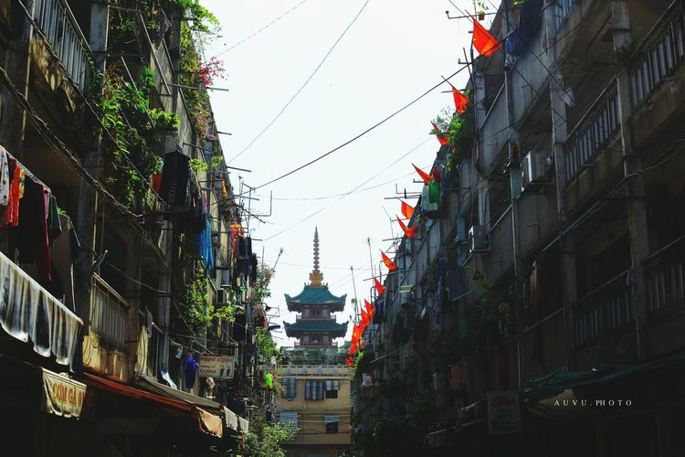 City Building Exterior Tree Architecture Built Structure Travel Destinations Sky Outdoors Celebration Skyscraper No People Tower Growth Illuminated Day Nature Cityscape Pagoda Redflag Vietnamflag ByAuVu