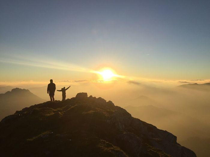 Mountain Sunlight Sun Real People Leisure Activity Standing Sky Mountain Range Silhouette Full Length Beauty In Nature Lifestyles Nature Rear View Adventure Scenics Outdoors Sunset One Person