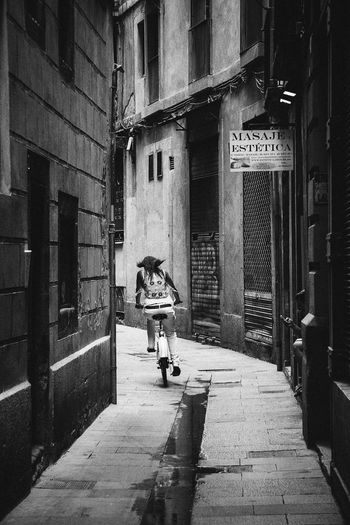 Architecture Barcelona Biking Blackandwhite Built Structure City City Life Narrow People And Places Person Rear View Street