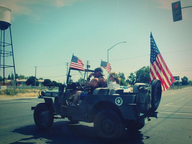Patriotism Flag Driving Army Pride American Flag America The Street Photographer - 2017 EyeEm Awards The Photojournalist - 2017 EyeEm Awards Live For The Story The Portraitist - 2017 EyeEm Awards