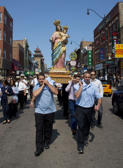 Procession in Chinatown, Chicago, for the 120th Anniversary Celebration of the Feast of Madonna Incoronata, 120th Anniversary Celebration Of The Feast Of The Madonna Incoro La Nostra Bella Madre Ricigliano, Italy SANTA MARIA INCOONATA Saint Therese Church Adult Adults Only Architecture Building Exterior Built Structure City Crowd Day Human Representation Large Group Of People Men Outdoors People Real People Sculpture Sky Statue Togetherness Women Young Adult The Week On EyeEm