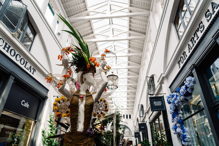 Fleurs de Villes Floral Couture Installation in Covent Garden Market Building. Architecture Built Structure Day Luxury Couture Fashion Blossom Springtime London Uk England Covent Garden  Covent Garden Market Floral Fleurs Landmark Extravaganza Shopping Artist Flower Low Angle View Plant Flowering Plant Building Exterior No People Building Nature City Ceiling Outdoors Decoration Text Growth Lighting Equipment Hanging Skylight Flower Arrangement