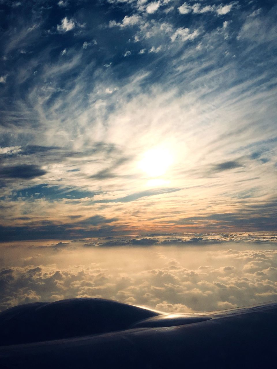 cloud - sky, sky, beauty in nature, scenics - nature, sunset, mode of transportation, no people, transportation, air vehicle, nature, airplane, flying, sun, cloudscape, sunlight, travel, outdoors, tranquility, tranquil scene, mid-air, bright