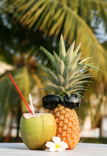 Fresh coconut drink and pineapple on the table Close-up Cocktail Coconut Day Drinking Straw Food Food And Drink Freshness Fruit Healthy Eating Healthy Lifestyle No People Outdoors Palm Tree Pineapple Refreshment Tropical Climate