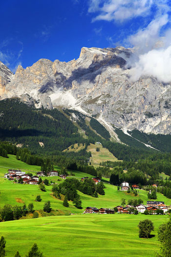 Houses On Field Against Dolomites
