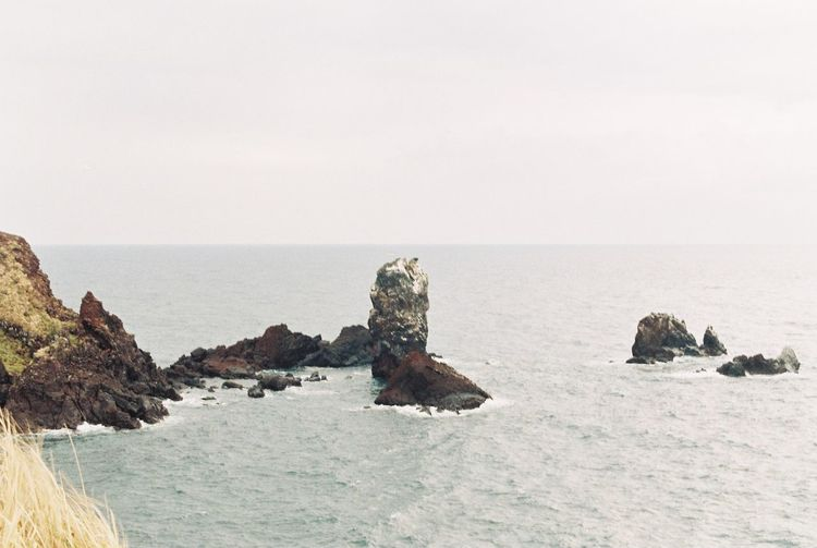 Film Nikon Beach Beauty In Nature Clear Sky Copy Space Environment Film Photography Horizon Horizon Over Water Land Marine Nature No People Outdoors Rock Rock - Object Scenics - Nature Sea Sky Strength Water Waterfront