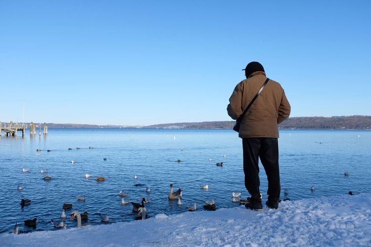 The Old Man and The Lake Winter Lake EyeEm Selects Rear View Standing One Person Clear Sky Men Water Outdoors EyeEmNewHere