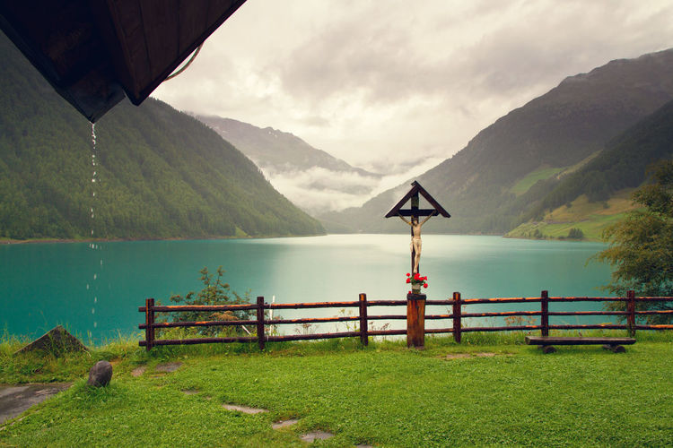 Mountain Water Scenics - Nature Beauty In Nature Sky Tranquility Mountain Range Tranquil Scene Nature Cloud - Sky Non-urban Scene Day Lake Plant No People Idyllic Environment Landscape Grass Outdoors Raindrops Christianity Crucifix Europe Alps Italy