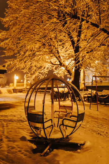 Snow in playground Night Tree Snow Cold Temperature Winter City Electric Lamp Park Playground