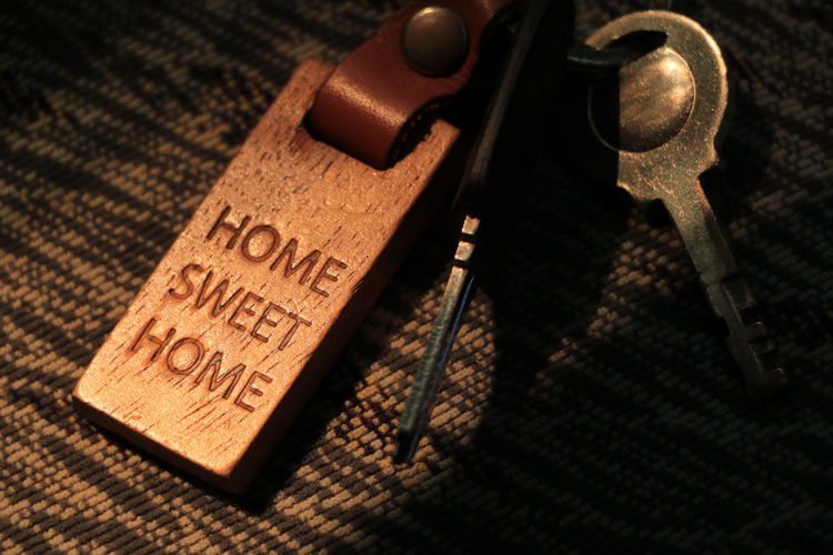 Home Domestic Life Keychain Key Protection Lock Access Home Sweet Home Indoors  Table Still Life No People Close-up Text High Angle View Antique Western Script Wood - Material Communication Shadow Leather Security Safety