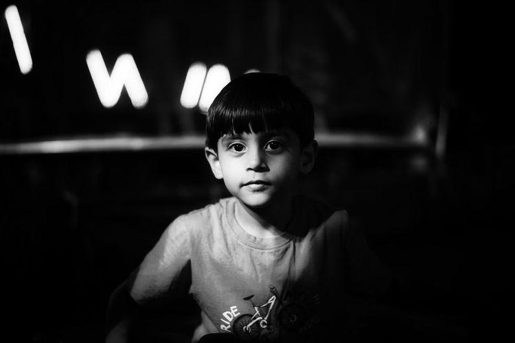Portrait Of Cute Boy In Darkroom