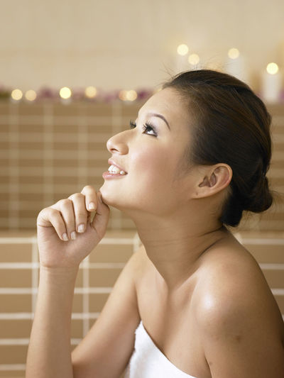 Close-Up Of Young Woman In Bathroom At Home