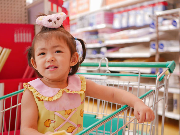 Little asian baby girl, 24 months old, enjoy being in a shopping cart waiting for her mother to do shopping Child Childhood Cute One Person Innocence Portrait Front View Indoors  Lifestyles Baby Females Girl Child Kid Standing Enjoy Smile Happy Asian  Little Toddler  Waiting Shopping Cart Staying Inside Superstore Supermarket Shop Store Stationary Buy Bring Along Experience Explore