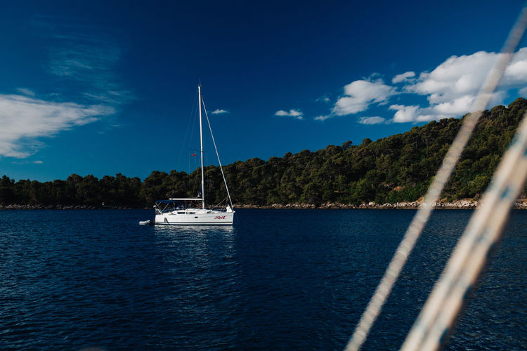 Boatlife Beauty In Nature Blue Boat Cloud - Sky Croatia Mast Mode Of Transport Moored Nature Nautical Vessel No People Outdoors Sailboat Sailing Sailing Ship Scenics Sea Sea And Sky Sky Tranquil Scene Tranquility Transportation Water Waterfront Yacht