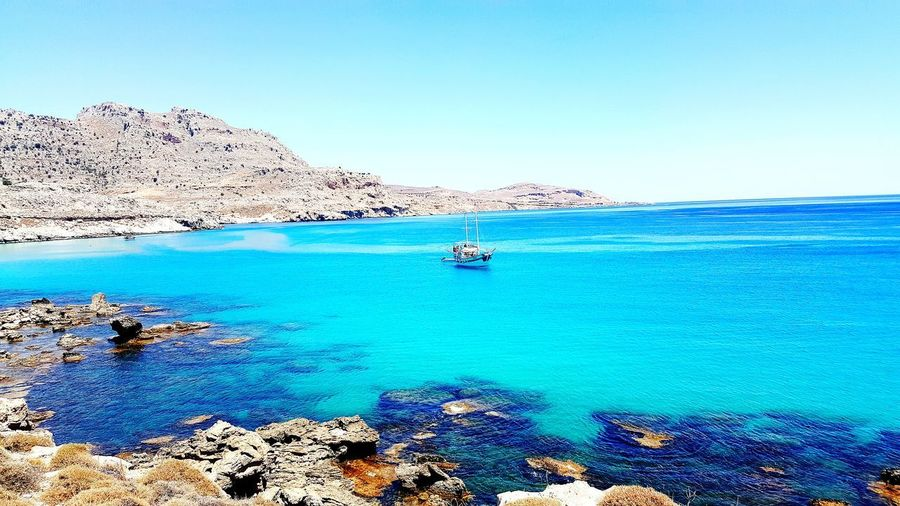 Sea Nautical Vessel Water Blue Outdoors Nature Beach Sailboat No People Transportation Travel Destinations Sky Scenics Beauty In Nature Clear Sky Summer Yacht Landscape GREECE ♥♥ Spirituality Sand Seaside Tree Beauty In Nature Horizon Over Water
