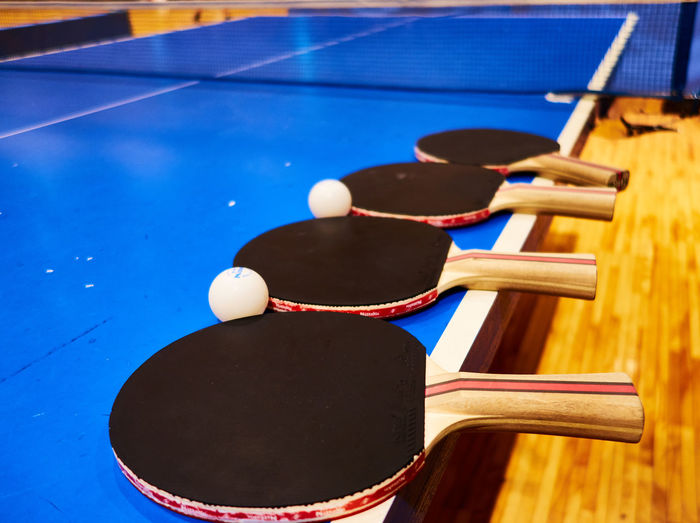 Close-up of sports equipment on table tennis