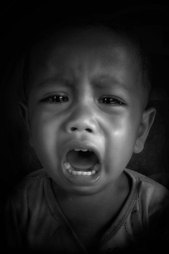 Close-up portrait of baby boy crying