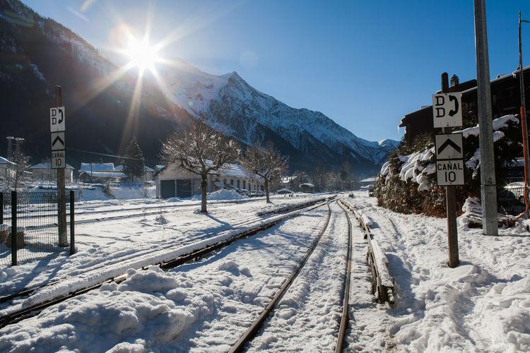 Sun Shining Over Snow Covered Mountain