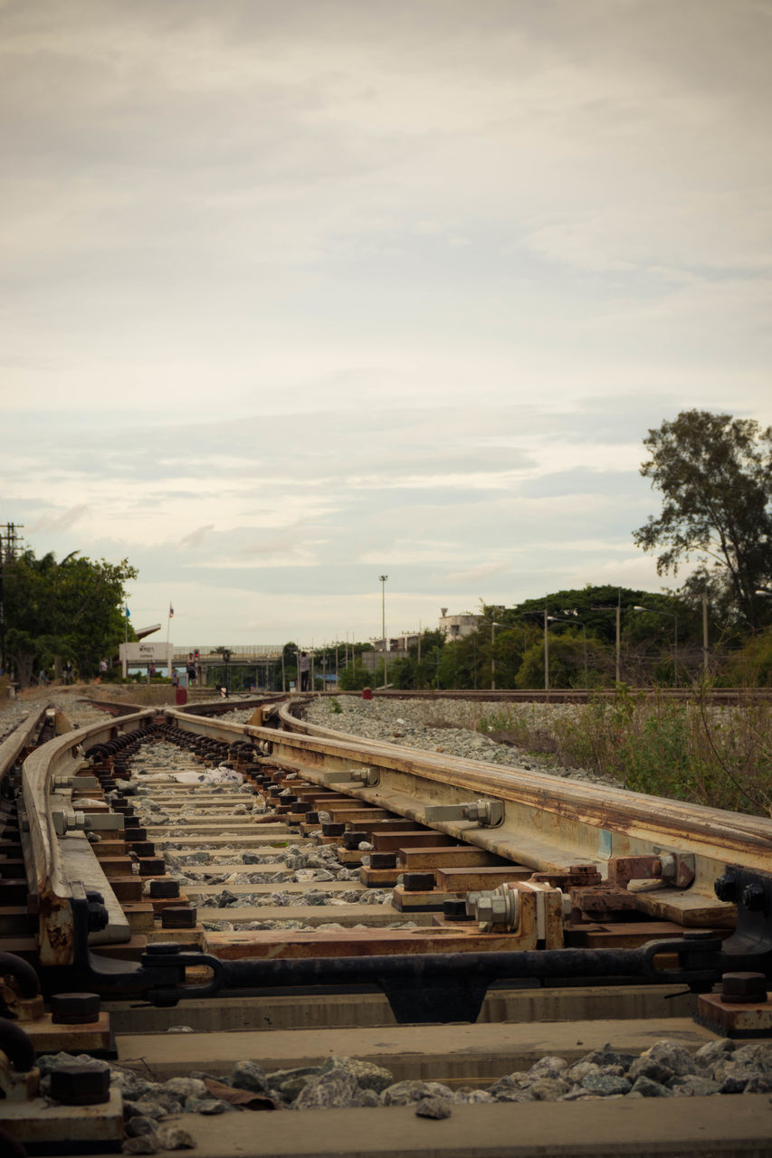 rail transportation, railroad track, track, transportation, sky, plant, cloud - sky, tree, nature, mode of transportation, no people, day, metal, train, outdoors, public transportation, diminishing perspective, abandoned, direction, the way forward, shunting yard