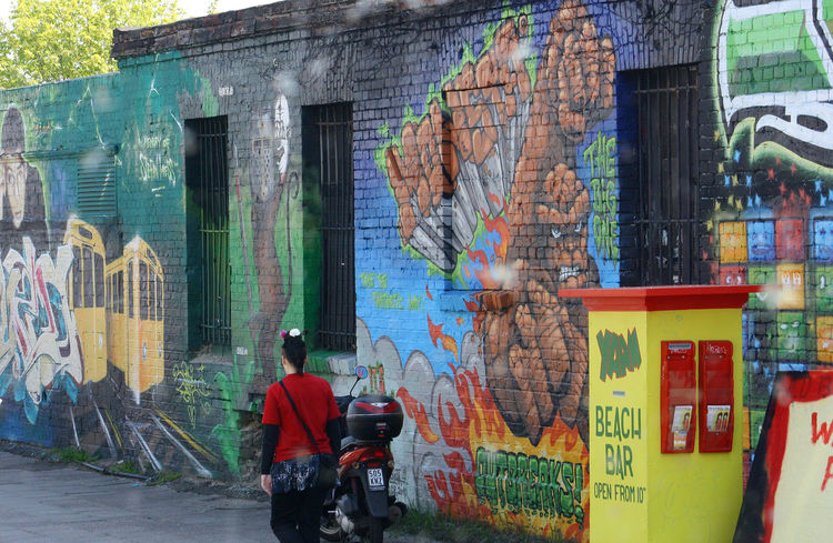 A Taste Of Berlin Beach Bar Berlin Photography Painted Wall Architecture Berlin Wall Graffiti Building Exterior Built Structure Colourful Scene Day Graffiti Men One Person Outdoors People Real People Yellow Box Berlin Love #FREIHEITBERLIN