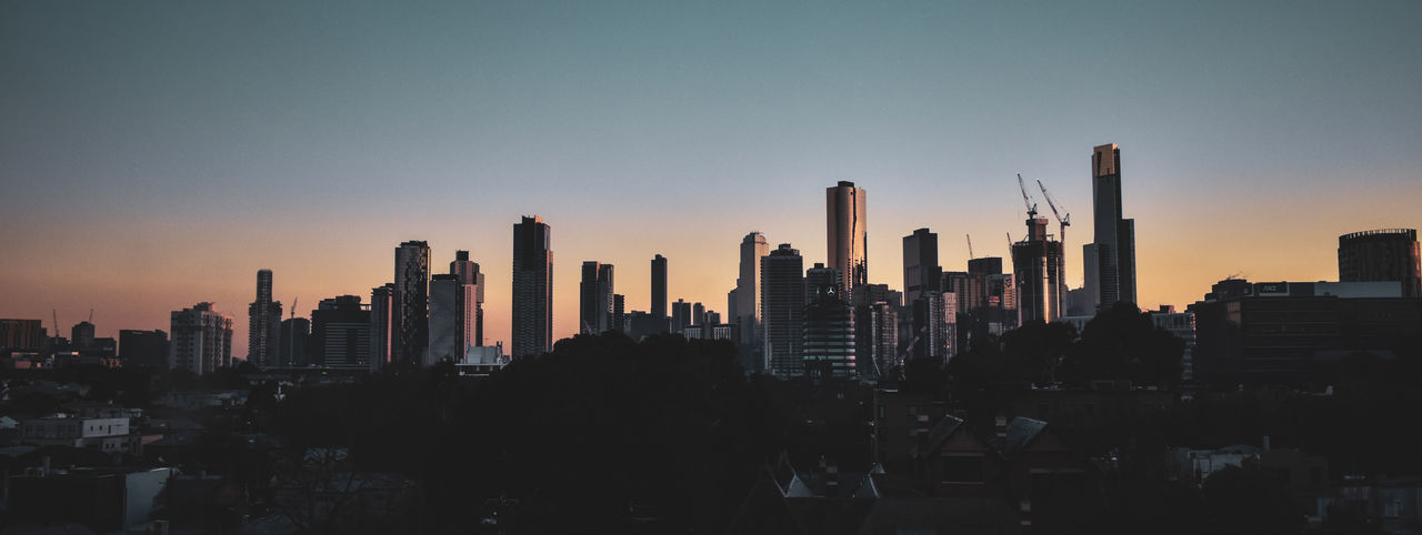 Good Morning, Melbourne. Sunrise Summer In The City City Cityscape Urban Skyline Modern Skyscraper Downtown District Business Finance And Industry Aerial View Illuminated Office Building High Rise Financial District  Infrastructure Skyline Office Building Exterior Panoramic Tower