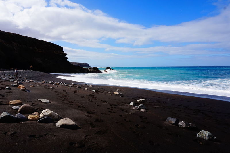 Black beach Black Sand Beach Blue Fuerteventura Enjoy The Moment Water Wave Sea Beach Sand Rock - Object Sun