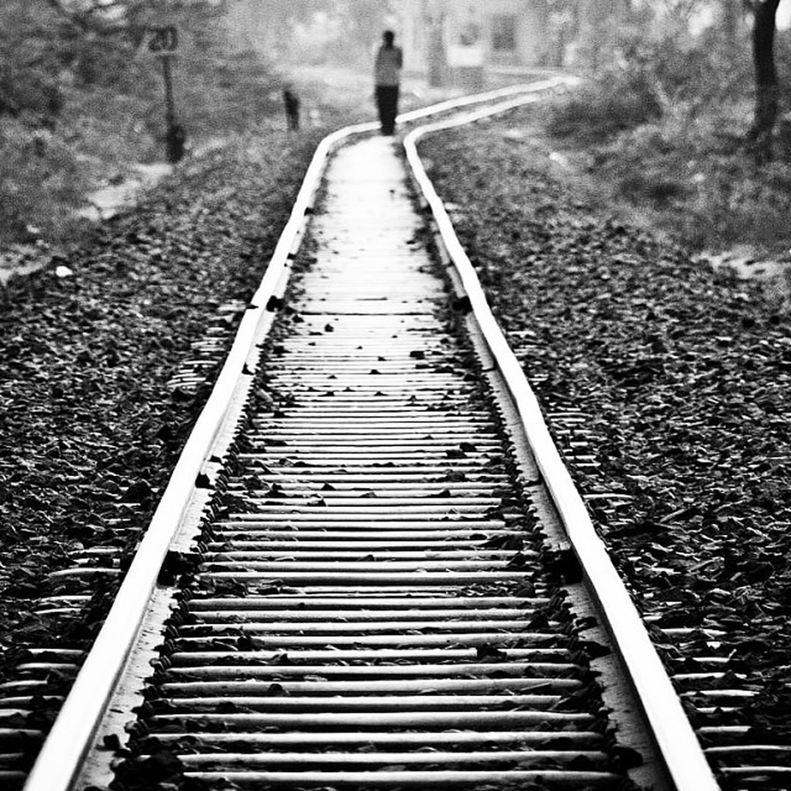 the way forward, walking, lifestyles, men, steps, rear view, diminishing perspective, full length, leisure activity, high angle view, railing, steps and staircases, day, vanishing point, railroad track, transportation, outdoors