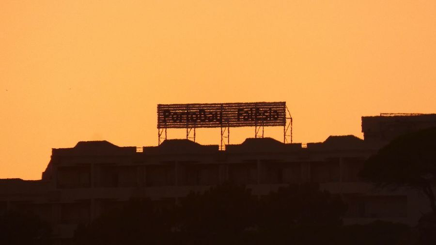Low angle view of silhouette buildings against sky during sunset