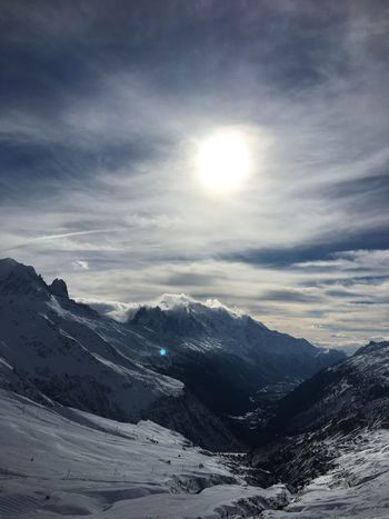 Beauty In Nature Cloud - Sky Cold Temperature Environment Landscape Mountain Mountain Peak Mountain Range Nature No People Range Scenics - Nature Sky Snow Snowcapped Mountain Sun Sunlight Tranquil Scene Tranquility Winter