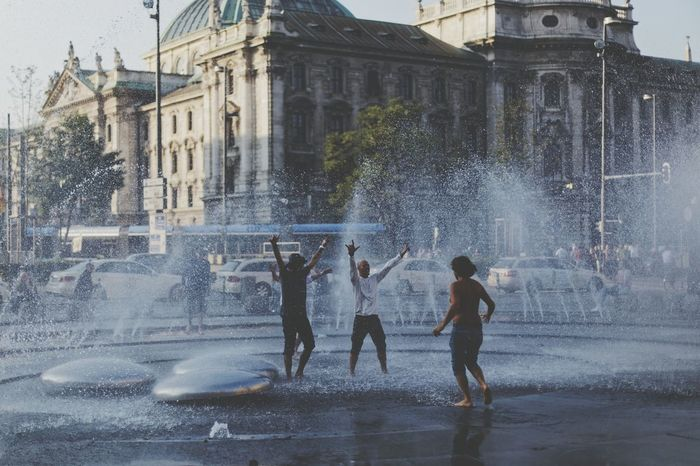 Snap A Stranger Built Structure Architecture Building Exterior Splashing Lifestyles Water Outdoors Fountain Day City Tree Motion Real People Men Adults Only People Adult Sky Fun Happiness