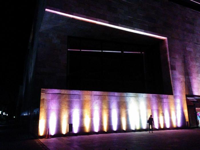 Full length of illuminated woman at night
