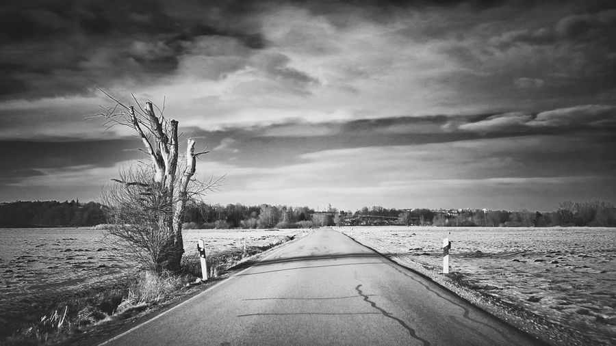 Winter road Black And White Blackandwhite Monochrome Tree Sky Road Winter Snow Field Bavaria Germany Cloud - Sky Nature No People Outdoors Growth Tree Water Scenics Agriculture Landscape Beauty In Nature The Traveler - 2018 EyeEm Awards