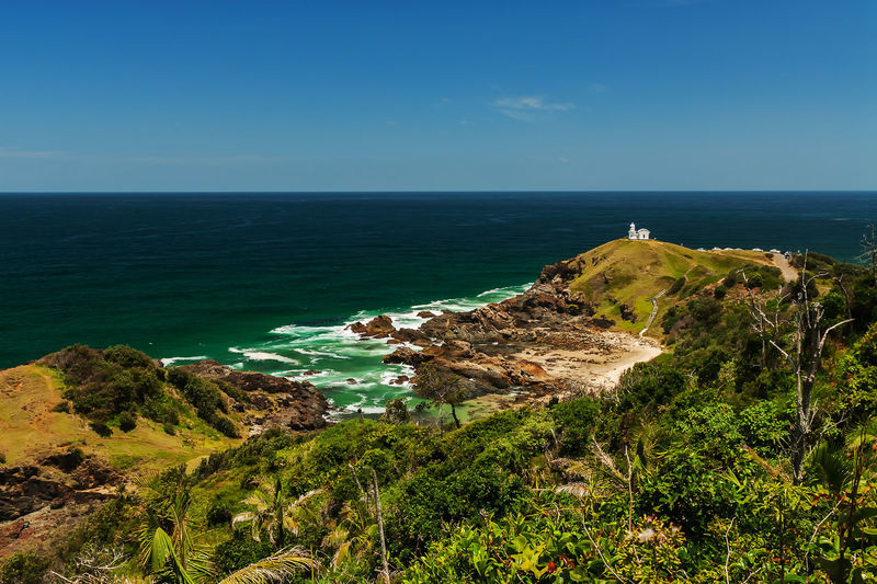 Australia New South Wales  Tacking Point Lighthouse, Beauty In Nature Blue Blue Sky Clear Sky Cliff Day Grass Horizon Over Water Idyllic Landscape Nature No People Outdoors Plant Port Macquarie Rock - Object Scenics Sea Sky Tranquil Scene Tranquility Water Lost In The Landscape