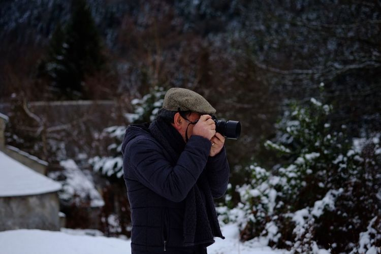 Man photographing from camera during winter