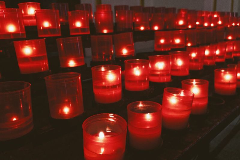 Candles 🕯... Candle Light Candles Burning Artificial Light Neat Plastic Ritual Church Candle Flame Red Wax Candlelight Candle Candle Light In A Row Illuminated Large Group Of Objects Red Fire Flame Burning Belief Religion Heat - Temperature Spirituality Fire - Natural Phenomenon Side By Side Order Indoors  Architecture No People