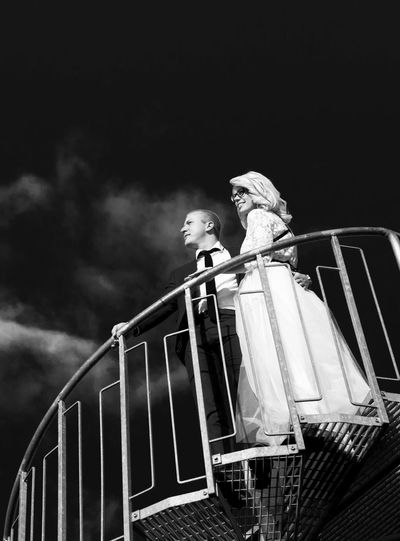 Bride and groom on their wedding day Adult Adults Only Backgrounds Black And White Blackandwhite Bride Day Dramatic Sky Film Noir Style Groom Low Angle View One Person Outdoors People Railing Staircase Wedding Couple Welcome To Black