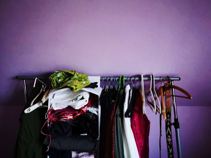 Clothes hanging on rack against wall