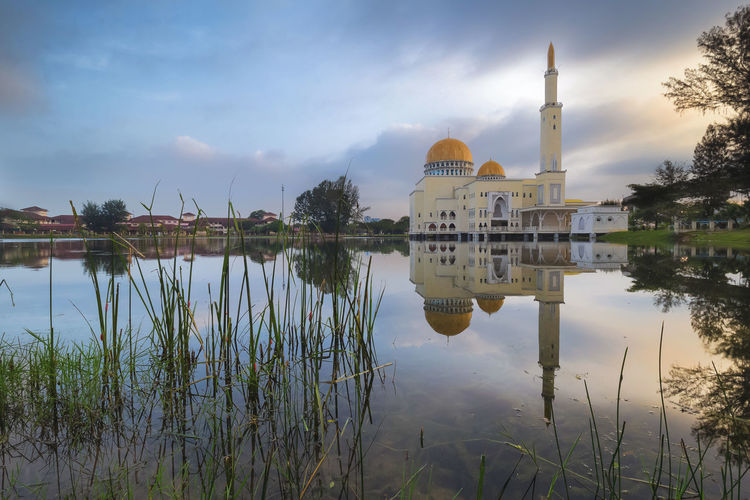 Masjid As Salam during morning Architecture Building Exterior Built Structure Cloud - Sky Day Dome Lake Nature No People Outdoors Place Of Worship Reflection Religion Sky Spirituality Travel Travel Destinations Tree Water Waterfront