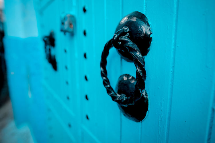 Close-up of blue door knocker