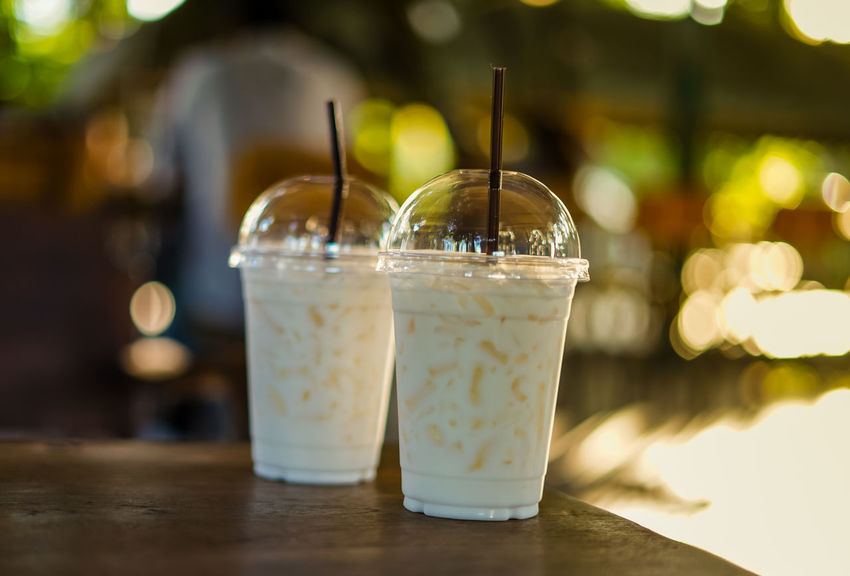 Glass of ice milk Beverage Coffee Time Freshness Ice Milkshake Cafe Close-up Cold Cow Milk Drink Drinking Drinking Glass Drinking Straw Focus On Foreground Food And Drink Freshness Glass Glass Of Milk Household Equipment Ice Milk Milktea Plastic Glass Refreshment Sweet Drink Table