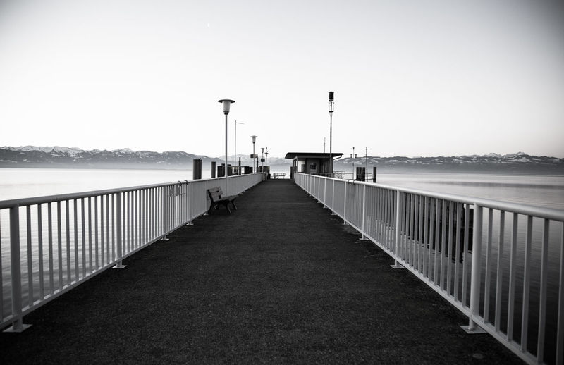 A new day Water Sky Railing The Way Forward Sea Street Light Direction Nature Clear Sky Architecture Built Structure Bridge Diminishing Perspective Transportation Day Connection Pier No People Street Outdoors Bridge - Man Made Structure Long Black And White Photography