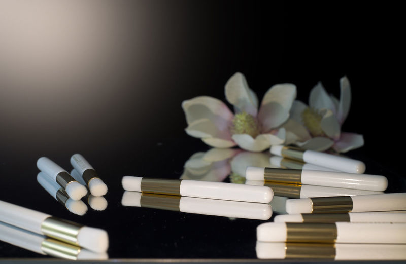 Close-up of white flowers on table