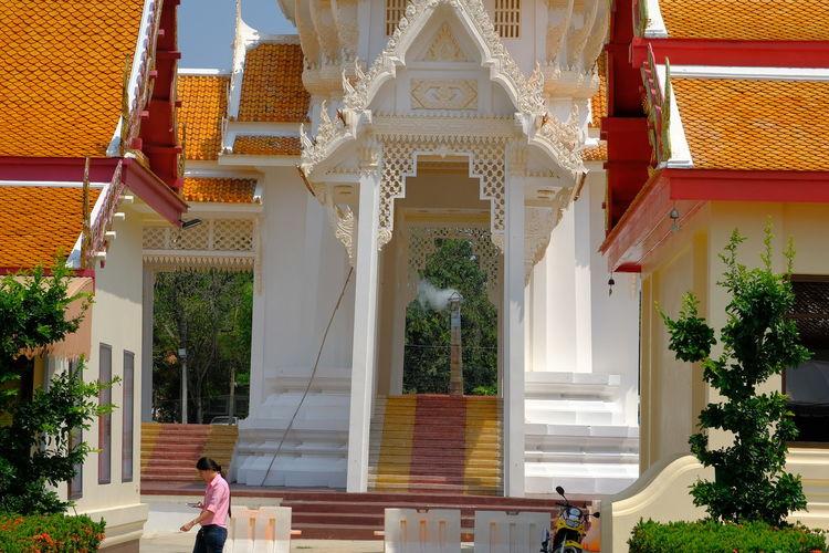Woman walking by temple