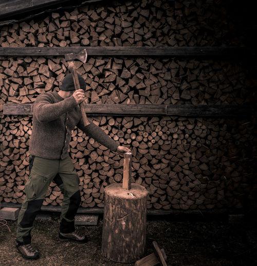 Man cutting logs
