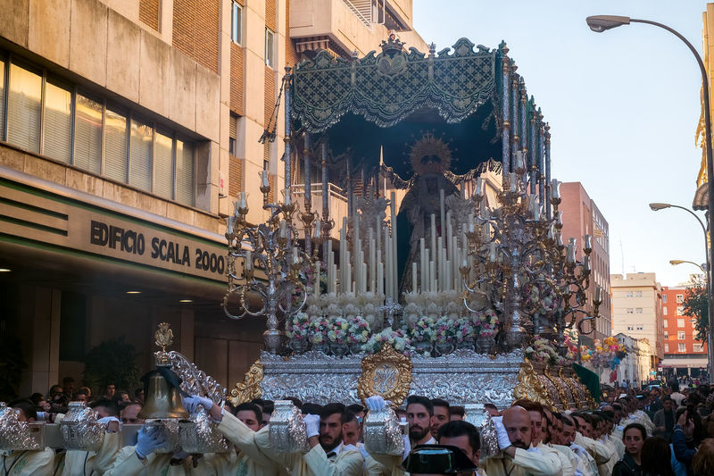 People in the procession in the Holy Week (Semana Santa) in a Spanish city. Malaga, Spain - March 26, 2018. Catolic Church Children Easter Easter Ready Historical Building Holy Week Malaga People Watching SPAIN Semana Santa Spanish Uniform Uniforms Adult Architecture Building Building Exterior Built Structure Catolicism Celebration City Crowd Day España Group Of People Large Group Of People Leisure Activity Lifestyles Men Musical Instrument Musician Musician Bands Old Buildings Old City Outdoors Procession Real People Religion Sculpture Spain Is Different Spanish Arquitecture Spanish Culture Street Women The Street Photographer - 2018 EyeEm Awards