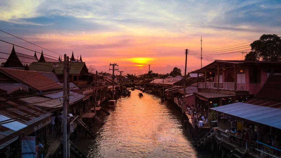 28 January 2018 Samut Songkhram Thailand boat in the river at Amphawa market Samut Songkhram Amphawa  Cityscape Songkhram Architecture Beauty In Nature Building Exterior Built Structure Cloud - Sky Day Nature Nautical Vessel No People Outdoors Scenics Sea Sky Sunset Water An Eye For Travel