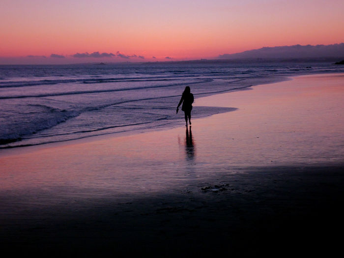 Beach sunset in Costa da Caparica Beach Sunset Full Length Sand Silhouette Sea One Person Walking Reflection Water Outdoors Only Women Adult Sky Tranquility Nature Beauty In Nature Scenics People Wave Sunset_collection Sunsetlover Traveling Sunsetporn Travel