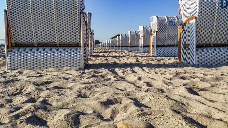 Hooded Beach Chairs On Sandy Beach